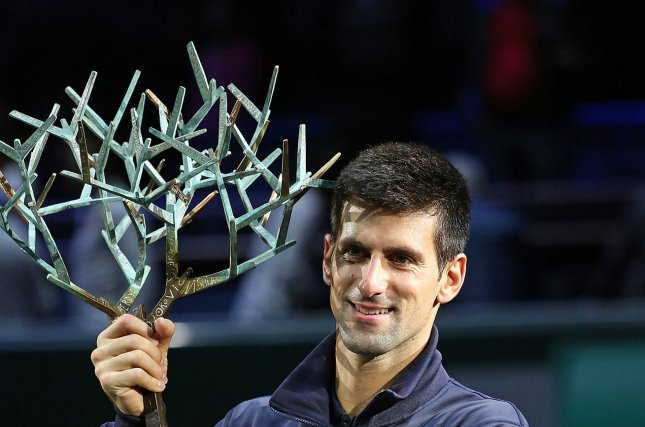 Novak Djokovic of Serbia holds the championship trophy after winning his finals match against Milos Raonic of Canada at the BNP Paribas Masters in Paris on November 2, 2014. Djokovic defeated Raonic 6-2, 6-3 to win his third Masters title in Paris and 20th Masters title overall. UPI/David Silpa