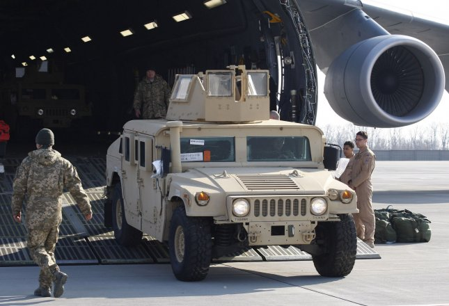 A U.S.Air Force plane delivers non-lethal military equipment, including ten Humvee vehicles, at the Kiev, Ukraine, airport on March 25, 2015. UPI/Ivan Vakolenko