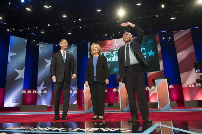 Democratic presidential candidates former Secretary of State Hillary Clinton (C), Sen. Bernie Sanders, D-Vt., (R) and former Gov. Martin O'Malley, R-Md., arrive on stage during the Democratic presidential primary debate at the Gaillard Center in Charleston, S.C., on January 17. Photo by Kevin Dietsch/UPI