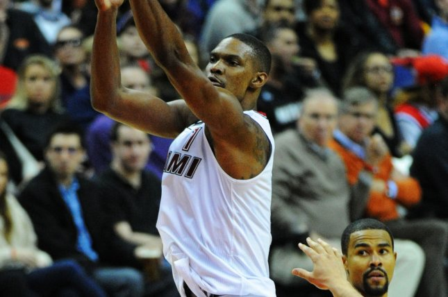 Miami Heat forward Chris Bosh (1) makes a three point basket against the Washington Wizards in the first half at the Verizon Center in Washington, D.C. on January 3, 2016. Photo by Mark Goldman/UPI