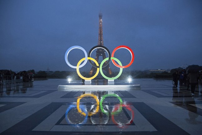 The Olympic rings are unveiled on the Trocadero square opposite the Eiffel Tower to celebrate Paris officially being awarded the 2024 Olympic Games on Wednesday. Photo by David Silpa/UPI