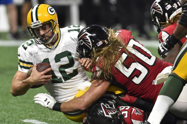 Green Bay Packers quarterback Aaron Rodgers (12) is sacked for a loss by Atlanta Falcons defenders Brooks Reed (50) and De'Vondre Campbell (59) during the first half of a season home opener football game on September 17, 2017 at Mercedes-Benz Stadium in Atlanta. Photo by David Tulis/UPI