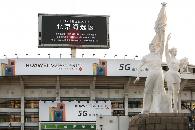 Advertisements for Huawei are seen on a stadium in central Beijing, China, on December 22, 2019. File Photo by Stephen Shaver/UPI