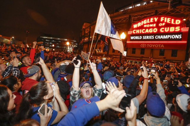 Chicago Cubs fans celebrate outside the Wrigley Field after the Game 7 of the World Series win against the Cleveland Indians on November 2 in Chicago. On August 8, 1988, the first night game at Chicago's Wrigley Field was played. File Photo by Kamil Krzaczynski/UPI