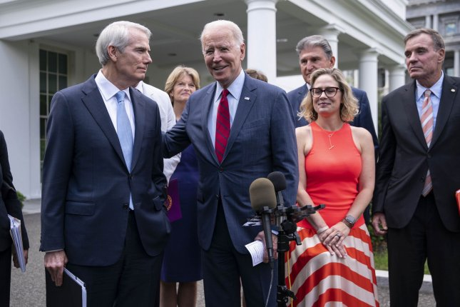 President Joe Biden speaks to reporters outside of the White House Thursday following a meeting with a bipartisan group of senators where they reached a deal on the infrastructure plan in Washington, D.C. Photo by Sarah Silbiger/UPI
