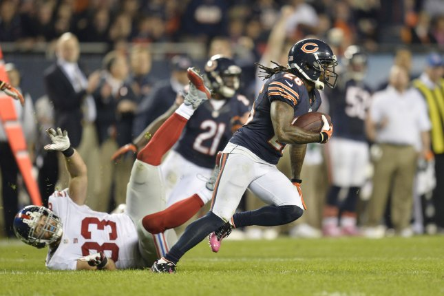 Chicago Bears cornerback Tim Jennings (R) intercepts a pass intended for New York Giants tight end Brandon Myers during the fourth quarter at Soldier Field in Chicago on October 10, 2013. The Bears defeated the Giants 27-21. UPI/Brian Kersey