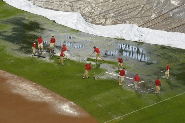 Members of the National grounds crew clear water from the outfield prior to the Nationals game against the San Francisco Giants at Nationals Park in Washington on June 3, 2009. (UPI Photo/Kevin Dietsch)