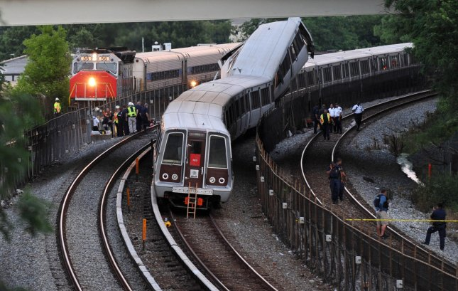 A MARC passenger train passes by the scene of a Metro train accident just outside the Fort Totten Metro station in Washington on June 22, 2009. A metro train crashed into the back of another stopped train. Six passengers are confirmed dead and over 100 injured. (UPI Photo/Kevin Dietsch)