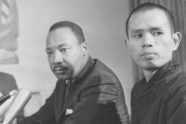 Martin Luther King, Jr. (L) holds a news conference with Thich Nhat Hanh, a Buddhist monk from Vietnam, on May 31, 1966. Hanh was in the United States to plead for peace in Vietnam. King came to connect the struggle for civil rights with the fight for economic justice and the early protests against the Vietnam War. UPI File Photo