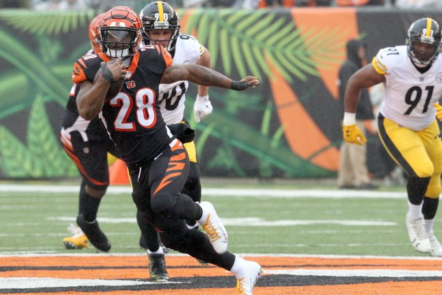 Cincinnati Bengals half back Joe Mixon (28) fights to break free from the Pittsburgh Steelers' defense during the first half of play on October 14 at Paul Brown Stadium in Cincinnati. Photo by John Sommers II/UPI