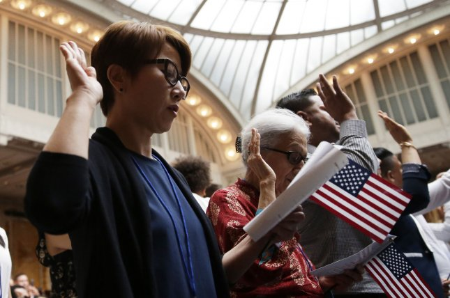 New citizens of the United States take the Oath of Allegiance during a naturalization ceremony at the Stephen A. Schwarzmann Building in New York City on July 3, 2018. File Photo by John Angelillo/UPI