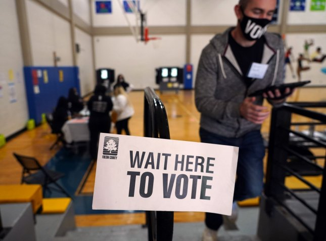 Civil rights groups sue Georgia over voting law