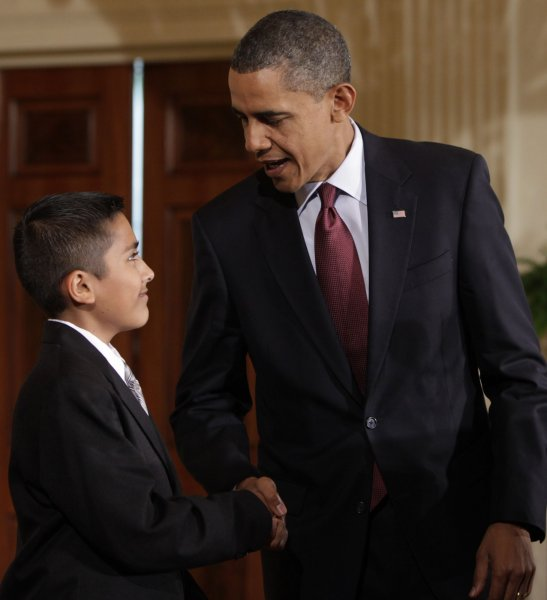 U.S. President Barack Obama shakes hands with Javier Garcia during a signing ceremony of the Executive Order on the White House Initiative on Educational Excellence for Hispanics at the White House in Washington, on October 19, 2010. UPI/Yuri Gripas/POOL