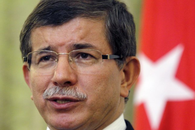 Turkish Prime Minister Ahmet Davutoglu, serving at the time as Turkey's foreign minister, speaks in Tehran, Iran, on July 10, 2011. In a meeting with European leaders in Brussels, Belgium, on Nov. 29, 2015, Davutoglu agreed to a deal in which the E.U. will provide Turkey with more than $3 billion in aid to stop Middle Eastern refugees from traveling to Europe. File photo by Maryam Rahmanian/ UPI
