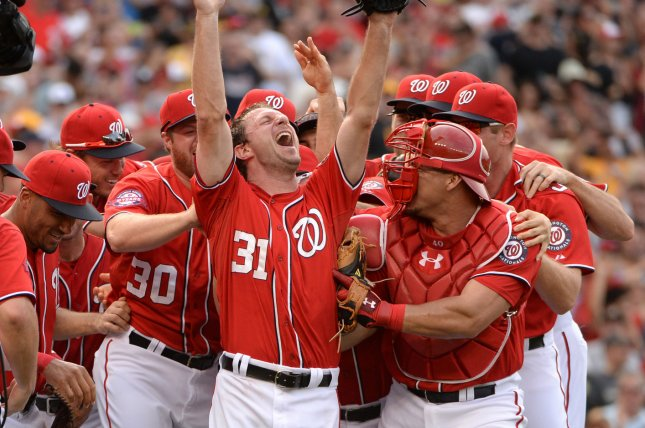 Washington Nationals pitcher Max Scherzer (31) jubilates with his teammates. Photo by Pat Benic/UPI