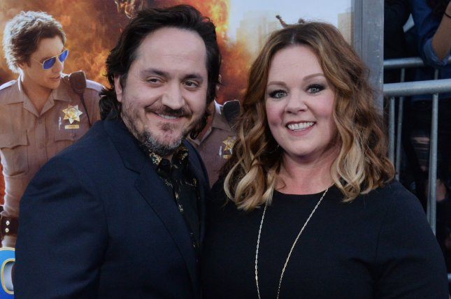 Melissa McCarthy (R) and her husband Ben Falcone attend the premiere of CHIPS on March 20. McCarthy was seen as Sean Spicer once again driving down the streets of New York City. File Photo by Jim Ruymen/UPI