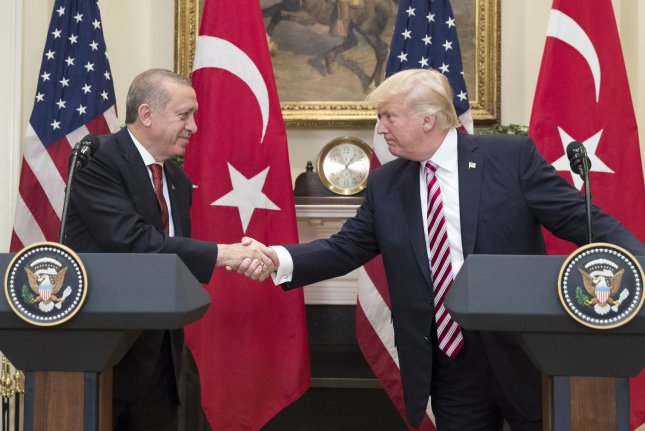 President Donald Trump shakes hands with Turkish President Recep Tayyip Erdogan in the Roosevelt Room of the White House on Tuesday, where they pledged cooperation in the fight against terrorism. Photo by Michael Reynolds/UPI