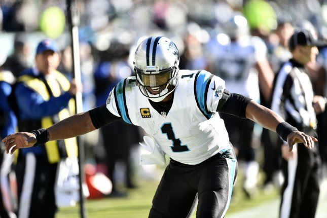 Carolina Panthers quarterback Cam Newton jokes on the sideline after a touchdown play during the fourth quarter against the Philadelphia Eagles on Sunday at Lincoln Financial Field in Philadelphia. Photo by Derik Hamilton/UPI