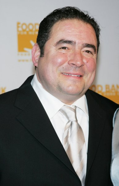 Emeril Lagasse arrives for the Food Bank for New York City's Sixth Annual Can-Do Awards Dinner honoring Jon Bon Jovi at Pier Sixty at Chelsea Piers in New York on April 21, 2009. He turns 59 on October 15. File Photo by Laura Cavanaugh/UPI