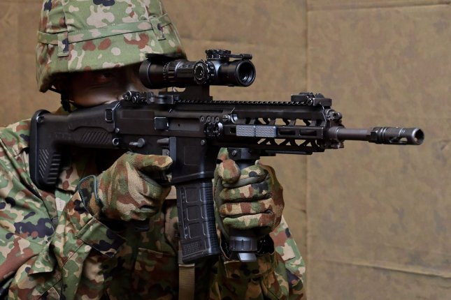 Member of Japan Ground Self-Defense Force holds new HOWA Type 20 assault rifle at the Defnce Ministry in Tokyo, Japan on Monday, May 18, 2020. Japan Ground Self-Defense Force's assault rifle updates for the first time in 31 years. Photo by Keizo Mori/UPI