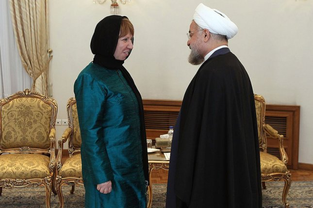 Former EU foreign policy chief Catherine Ashton (L) speaks with Iranian President Hassan Rouhani at the presidential palace in Tehran in 2014. File Photo courtesy of the President of Iran