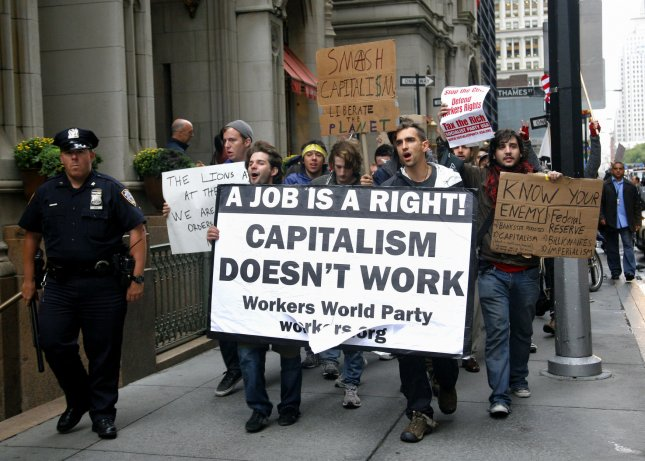 Demonstrators march though the Financial District under a heavy police presence as they protest the economic system on September 20, 2011 in New York City. People are taking part in the multi-day protest organized by Occupy Wall Street by camping out in near-by Zuccotti Park and marching through the financial district as people make their way to work. UPI/Monika Graff