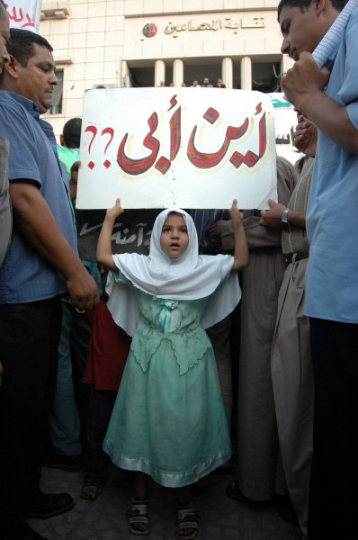 A young girl carrying a banner reading 'Where is my Father?' at an anti-Mubarak demonstration at the Society of Lawyers in downtown Cairo on September 1, 2005. Under intense security measures and with hundreds of riot troops deployed, demonstrators from three opposition parties, including the banned Muslim Brotherhood, gathered outside the Union of Lawyers in downtown Cairo calling on the ouster of incumbent President Hosni Mubarak, the release of political prisoners and suspension of emergency (martial) law under which Egypt has been ruled for over two decades. (UPI Photo/Stewart Innes)