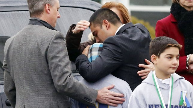 Mourners react in sorrow before the funeral for six-year-old Jack Pinto at the Honan Funeral Home near Sandy Hook Elementary School in Newtown, Connecticut following a shooting three days before that left 26 people dead including 20 children on December 17, 2012. A gunman opened fire inside Sandy Hook Elementary School early Friday morning. The gunman 20-year-old Adam Lanza killed himself following the shooting rampage inside the school. UPI/John Angelillo