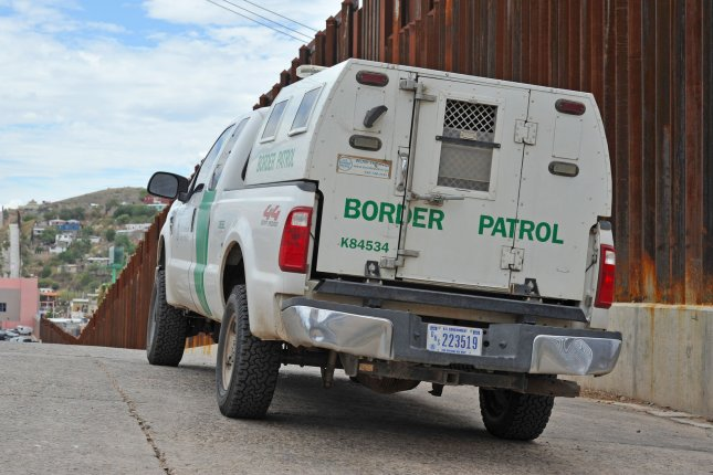A United States Border Patrol truck sits next to the border fence between the United States and Mexico near Nogales, Ariz., on July 13, 2014. More than 57,000 children from Central America have crossed the U.S. border alone since October 1, 2013. President Obama has asked congress for $3.7 million to deal with the influx. UPI/Art Foxall