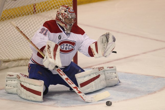 Montreal Canadiens goaltender Carey Price sets up to make a save on the St. Louis Blues in the third period Feb. 24 at the Scottrade Center in St. Louis. Price won the Hart Trophy, Vezina Trophy and Ted Lindsay Award on Wednesday at the NHL Awards. File photo by Bill Greenblatt/UPI