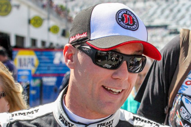Kevin Harvick signs autographs for fans during a break in practice for the Daytona 500 at Daytona International Speedway on February 20, 2016 in Daytona, Florida. Photo by Mike Gentry/UPI