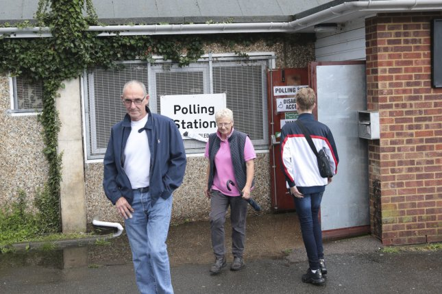 Voters leave a polling station in Westminster after casting their votes in the Brexit referendum on Thursday. North Korea made an unusual statement regarding the referendum on Monday. Photo by Hugo Philpott/UPI