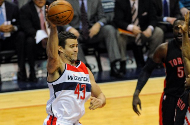 Former Washington Wizards forward Kris Humphries (43) leaps to keep a ball in bounds against the Toronto Raptors in the first half at the Verizon Center in Washington, D.C. on January 31, 2015. Photo by Mark Goldman/UPI