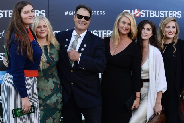 Dan Aykroyd, his wife Donna Dixon and family attend the premiere of Ghostbusters on July 9. Aykroyd has penned a tribute letter to Carrie Fisher where he describes the actress as a one-off, broke-the-mould woman. File Photo by Jim Ruymen/UPI