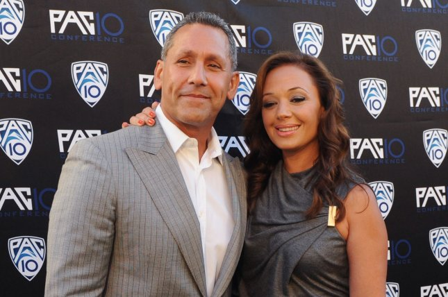 Leah Remini and her husband Angelo Pagan attend FOX Sports/PAC-10 Conference Hollywood premiere night on July 29, 2010. In a new interview on Real Time with Bill Maher, Remini said she believes Tom Cruise has the power to stop Scientology. File Photo by Jim Ruymen/UPI
