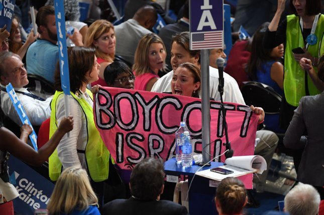 A protester holds a banner reading Boycott Israel on the convention floor during Day 4 of the Democratic National Convention at Wells Fargo Center in Philadelphia on July 28. Free speech advocates say a bill to limit businesses' ability to boycott trade with Israel would impinge on the First Amendment. File Photo by Pat Benic/UPI