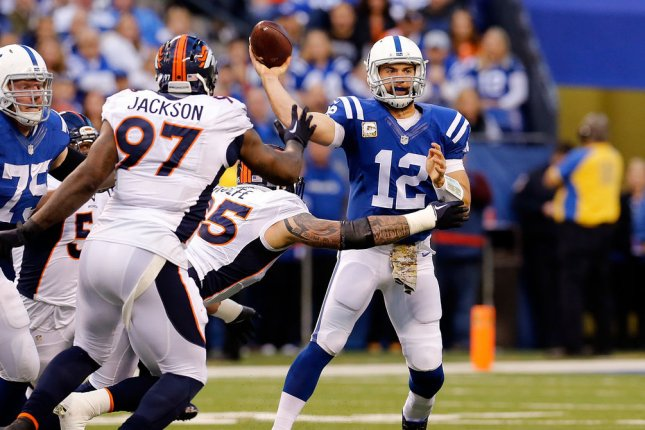 Indianapolis Colts quarterback Andrew Luck (12) throws under pressure from Denver Broncos defensive lineman Derek Wolfe (95) during the first half of play on November 8, 2015 at Lucas Oil Stadium in Indianapolis, Indiana. File photo by John Sommers II/UPI