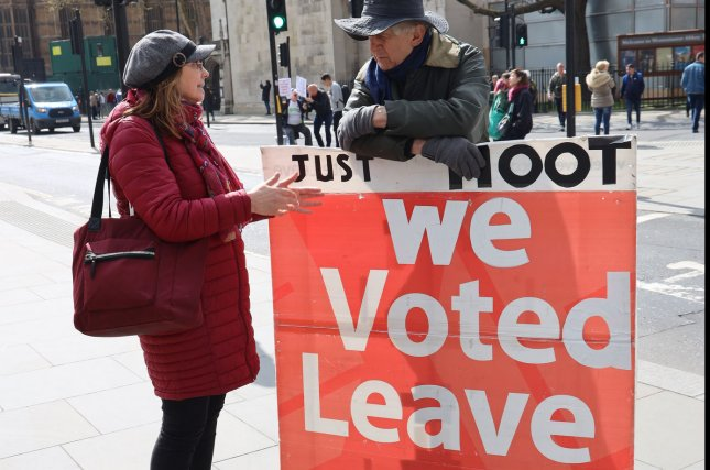 Pro-exit protesters campaign outside the Houses of Parliament in London on April 3. File Photo by Hugo Philpott/UPI