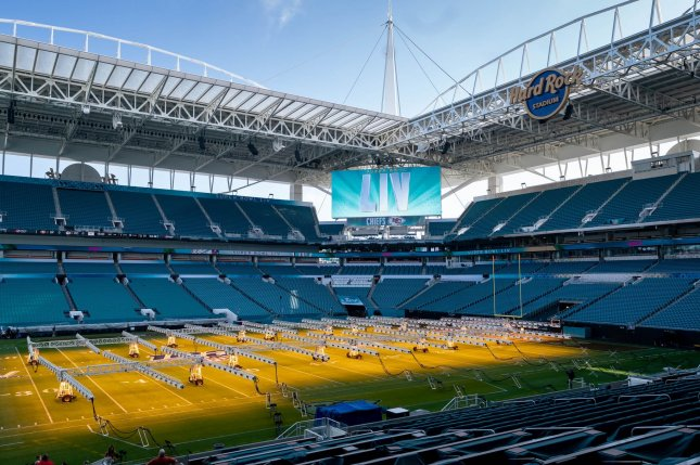 Grow lights are seen on the field at Hard Rock Stadium Tuesday in preparation for Sunday's Super Bowl LIV in Miami Gardens, Fla. Photo by Kevin Dietsch/UPI
