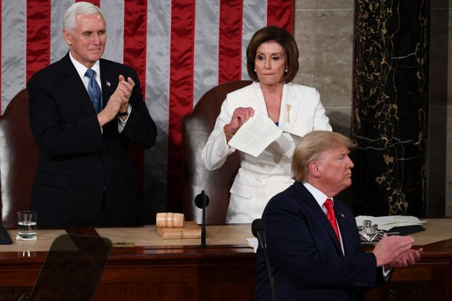 House Speaker Nancy Pelosi tears up her copy of President Donald Trump's State of the Union address at the U.S. Capitol Tuesday night. Vice President Mike Pence applauds at left. Photo by Kevin Dietsch/UPI
