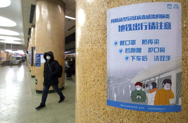 Public service announcements telling people to wear protective face masks are placed in a subway as the coronavirus continues to threaten Beijing on Thursday. Photo by Stephen Shaver/UPI