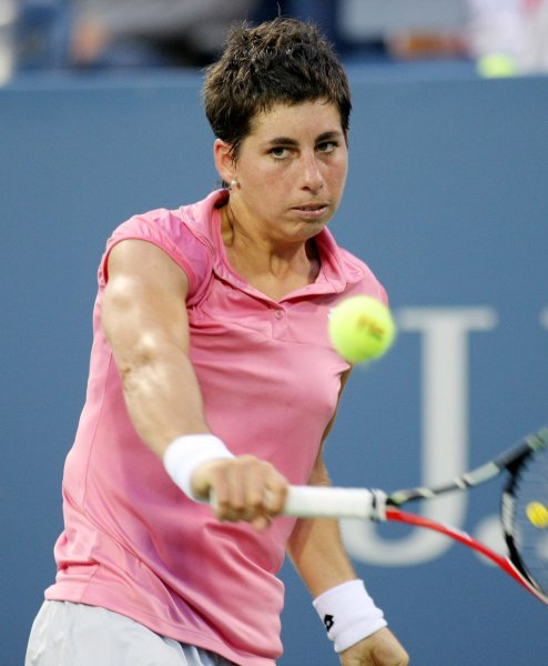 Carla Suarez Navarro. shown in a 2011 file photo, picked up a first-round win Monday at the Portugal Open. UPI/Monika Graff