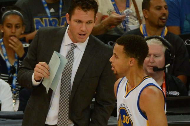 Golden State Warriors Stephen Curry (30) talks with interim coach Luke Walton in the first quarter of a preseason game against the Denver Nuggets at Oracle Arena in Oakland, California on October 13, 2015. The Nuggets defeated the the Warriors 114-103. Photo by Terry Schmitt/UPI