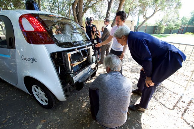 U.S. Secretary of State John Kerry looks at the computers inside one of Google's self-driving vehicles at the 2016 Global Entrepreneurship's Innovation Marketplace in Stanford, Calif., on June 23. Tuesday, Google announced that the vehicles will be handled by the new independent company Waymo, which branched off from Google's X unit. File Photo by U.S. Department of State/UPI