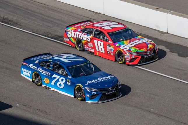 Martin Truex Jr (78) and Kyle Busch race off pit row during the 2017 Brickyard 400, at the Indianapolis Motor Speedway on July 23, 2017 in Indianapolis, Indiana. File photo by Edwin Locke/UPI