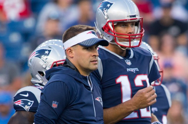 New England Patriots quarterback Tom Brady (R) and offensive coordinator Josh McDaniels during warm ups before a preseason game against the Jacksonville Jaguars on August 10 at Gillette Stadium in Foxborough, Mass. File photo by Matthew Healey/UPI