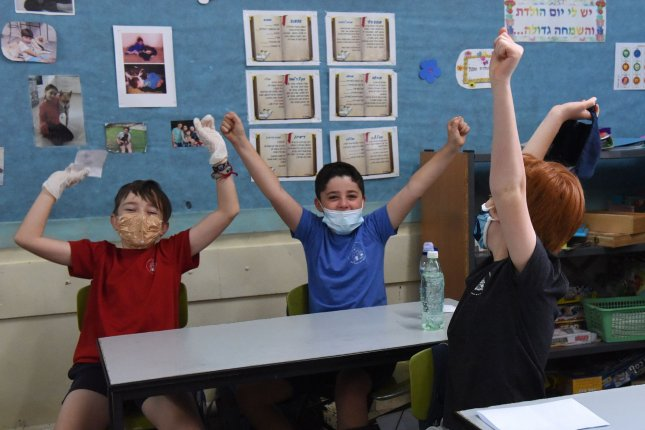 Data on spread of COVID-19 in children remains limited even as cities across the U.S. debate reopening schools, experts say. Pictured, Israeli students wear protective masks as they return to the Yankus Korchak Elementary School in Jerusalem in May. Photo by Debbie Hill/UPI