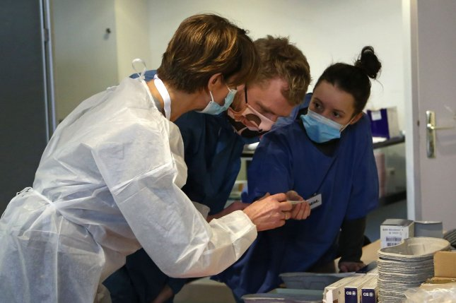 French medical workers prepare to receive vials of Covid-19 vaccines at the town hall of the 5th district in Paris Jan. 18. The French government approved use of the one-dose Johnson & Johnson vaccine Friday. Photo by David Silpa/UPI