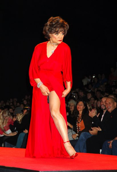 Eartha Kitt ..modeling in the Heart Truth Red Dress Collection 2006 ..Fashion Show under the Tent at Bryant Park at Olympus ..Fashion Week on National Wear Red Day, Friday February 3, 2006. The Heart Truth is a national awareness campaign for women about heart disease. ..Photo by Robin Platzer/UPI