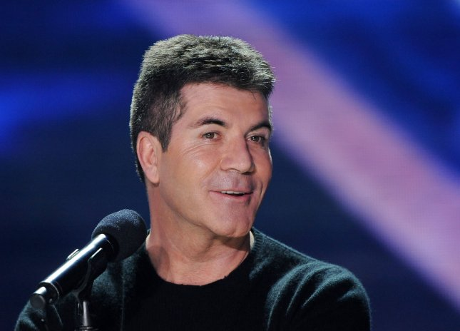 The X Factor judge Simon Cowell attends The X Factor news conference at CBS Television City in Los Angeles on December 19, 2011. UPI/Jim Ruymen